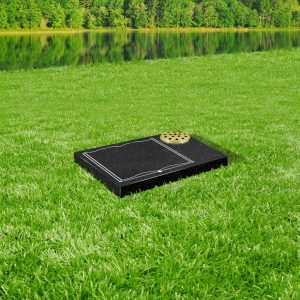 Black granite tablet memorial mounted on grass