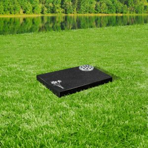 Black granite tablet memorial mounted on grass