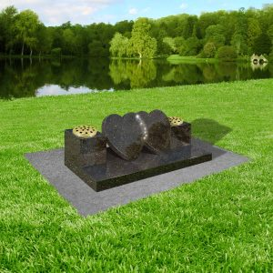 Black-star-galaxy-granite-with-concrete-base-at-thornhill-memorials-masons-of-grave-and-cremation-stones-cardiff-MS334