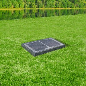 Blue pearl granite tablet memorial mounted on grass