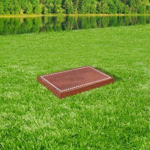 Red granite tablet memorial mounted on grass